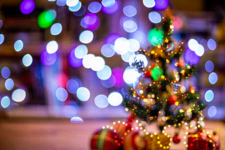 lights and christmas tree on colorful defocused background. 免版税图像