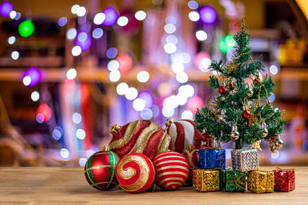 Christmas tree with decorations on colorful background.