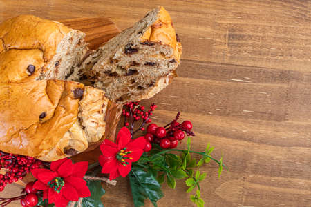 Panettone with chocolate on wooden table, traditional Italian dessert cake for Christmas. Top view. Space for text. Imagens