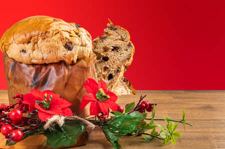 Panettone with chocolate, traditional Italian dessert cake for Christmas. With red background. Imagens