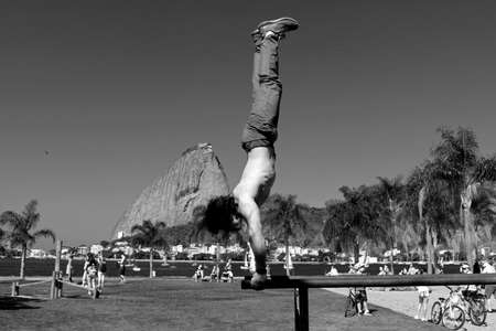 Acrobat in the park of Flamengo with the Sugar Loaf in the background