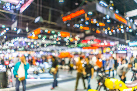 Abstract blurred background image with bokeh light of crowd people at cars exhibition show Imagens