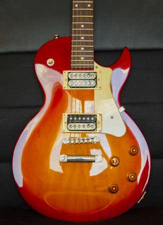 Guitar model Les Paul, red and yellow