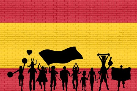 Spanish supporter silhouette in front of brick wall with Spain flag. All the objects, silhouettes and the brick wall are in different layers.