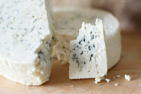 Whole truckle of stilton cheese viewed from above.