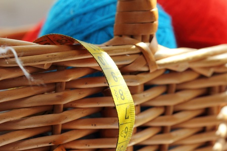 basket embroidery: red and blue balls of yarn for needlework