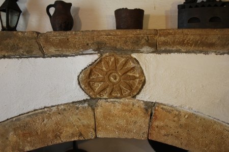 antique dishes: mantelpiece with antique dishes in a rustic house