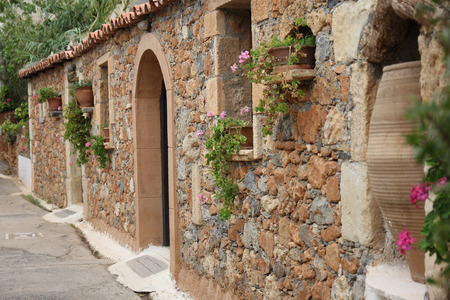 Greek village house with a tiled roof and flowers Stock Photo - 22682054