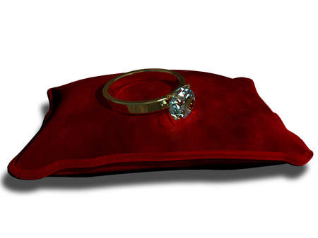 red velvet: precious ring with a stone on a red cushion Stock Photo