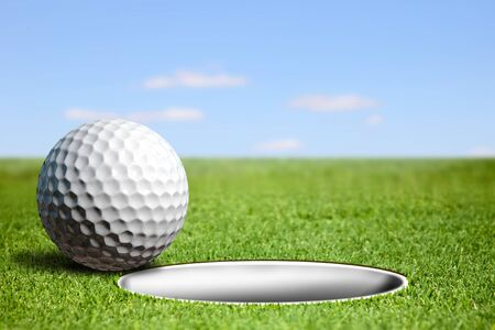 fields  grass: Abstract illustration golf ball at the hole Stock Photo