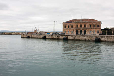 ortigia: Italy Sicily Siracuse Port captain Stock Photo
