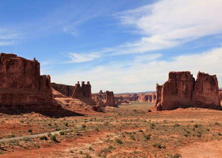 Giant desert monoliths loom over an arid landscape