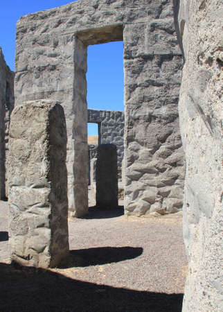 keystone light: Light and shadow play amidst concrete monoliths at stonehenge replica Stock Photo