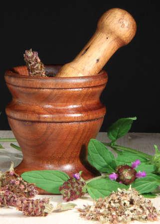 Mortar and Pestle with Selfheal (Prunella vulgaris) herb photo