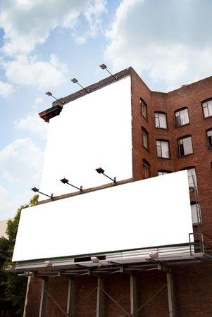 Twee bank billboards op Brick bouw Stockfoto