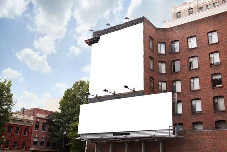 billboard advertising: Two Bank Billboards on Brick Building in Urban Area