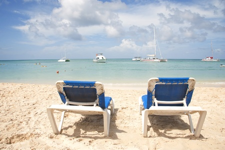 Blue Lounge Chairs on the Beach with Puffy Clouds Stock Photo - 8645552