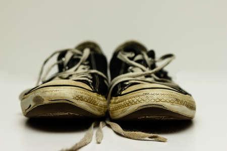 worn: Old, worn Black Converse Sneakers.