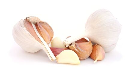 Bulbs and cloves of garlic isolated on a white background. photo