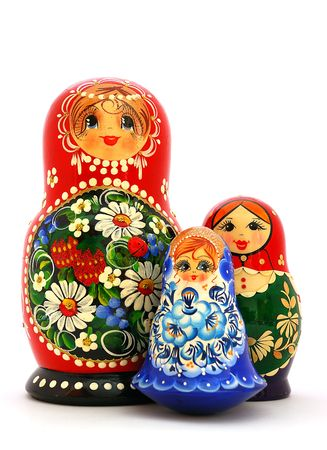 nesting: Three different russian nesting dolls on a white background. Stock Photo