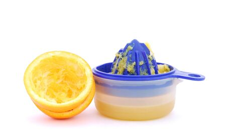 juice squeezer: Juice squeezer with fresh orange juice and two halves of the orange on white background.