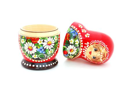 russian nesting dolls: An opened Russian doll on a white background.
