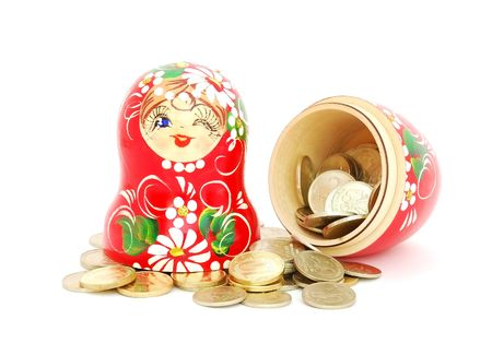 matroshka: An opened russian nesting doll with russian rubles coins on white background.