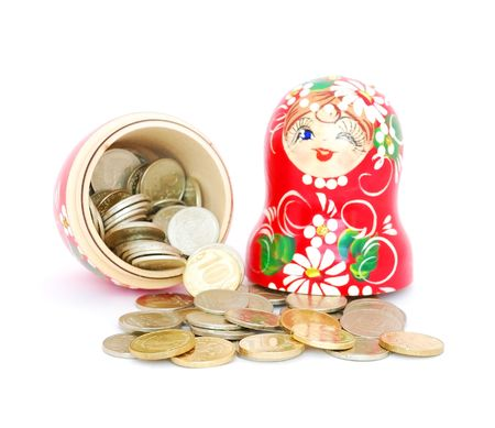 An opened russian nesting doll with russian rubles coins on white background.