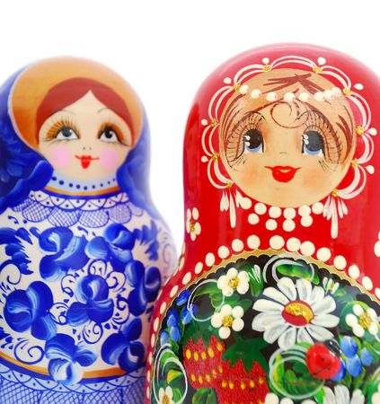 Close-up of two Russian Dolls on white background. photo