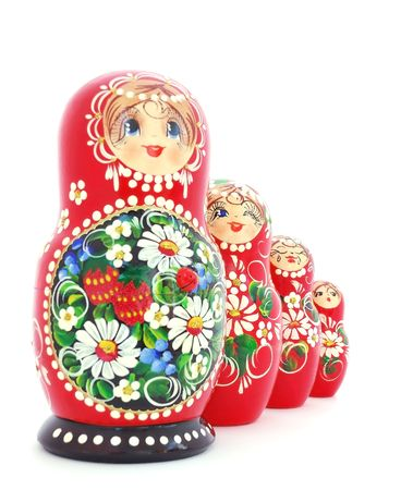 Russian nested dolls standing in a row on white background. photo