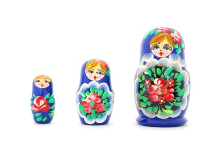 Set of russian nested dolls standing in a row on white background. photo