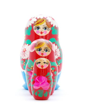 Three Russian dolls standing one one by one on white background. photo