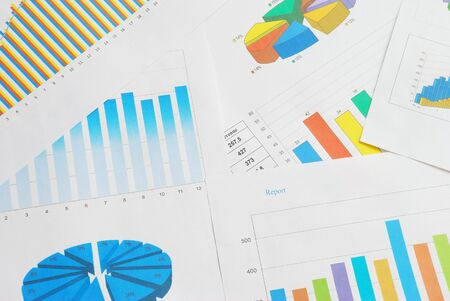 Top view of finance documents with colorful graphs and charts. Stock Photo - 6940370