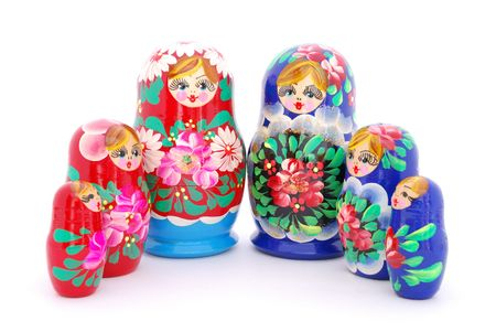 Red and blue Russian dolls on white background. photo