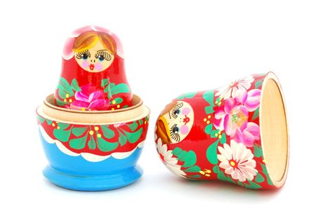 russian nesting dolls: An opened Russian doll on white background. Stock Photo
