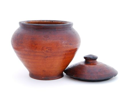 old container: An old clay pot with lid on white background.