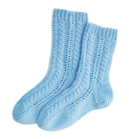 needlecraft: Blue woolen socks on white background