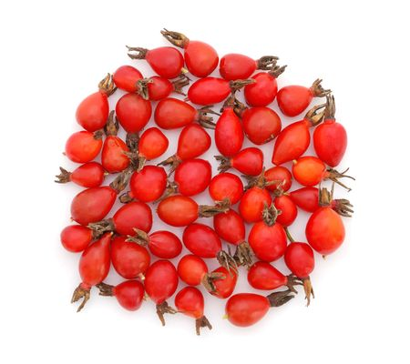 Heap of rose hips on white background photo