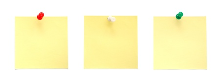 Yellow sticky notes with push pins photo