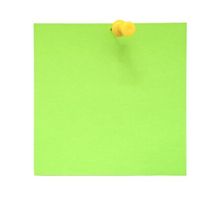 Green sticky note with yellow pushpin  photo