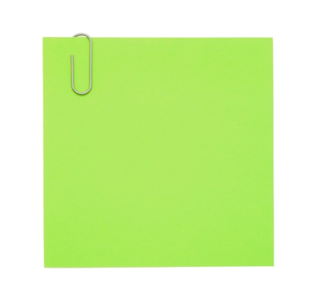 bulletinboard: Green paper note with paper clip Stock Photo