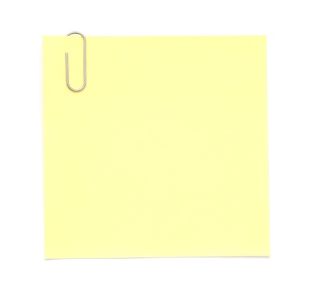 Yellow paper note with paper clip photo