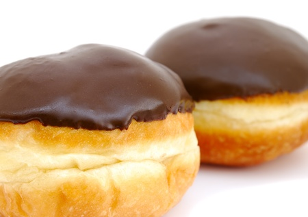 Close-up of chocolate doughnuts on white background photo