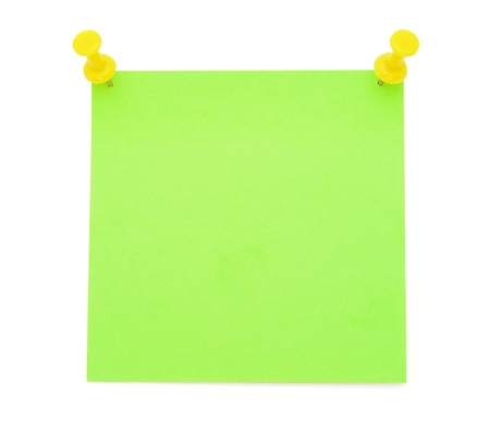 Green post-it note with yellow pushpins photo