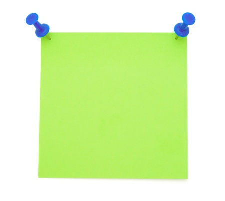 push pins: Green Post-it Note with Pushpins