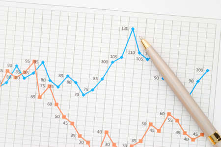A pen pointing at the financial graph Stock Photo - 9368389