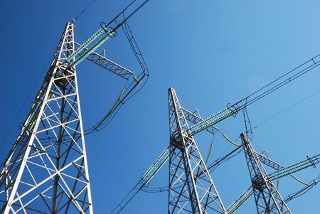 Electricity pylons on the sky background photo