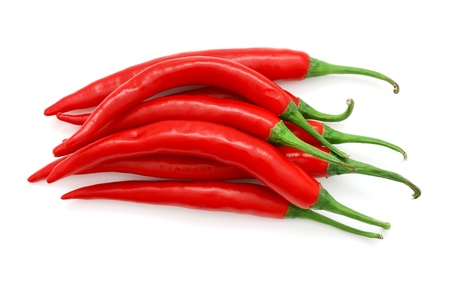red chilli: The heap of red hot chili peppers isolated on white background Stock Photo