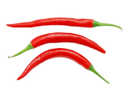 spicy chilli: Three red hot chili peppers isolated on white background