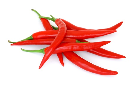 The heap of red hot chili peppers isolated on white background  photo